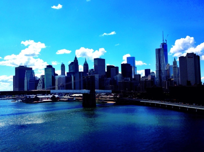 view of the new york skyline from the manhattan bridge.