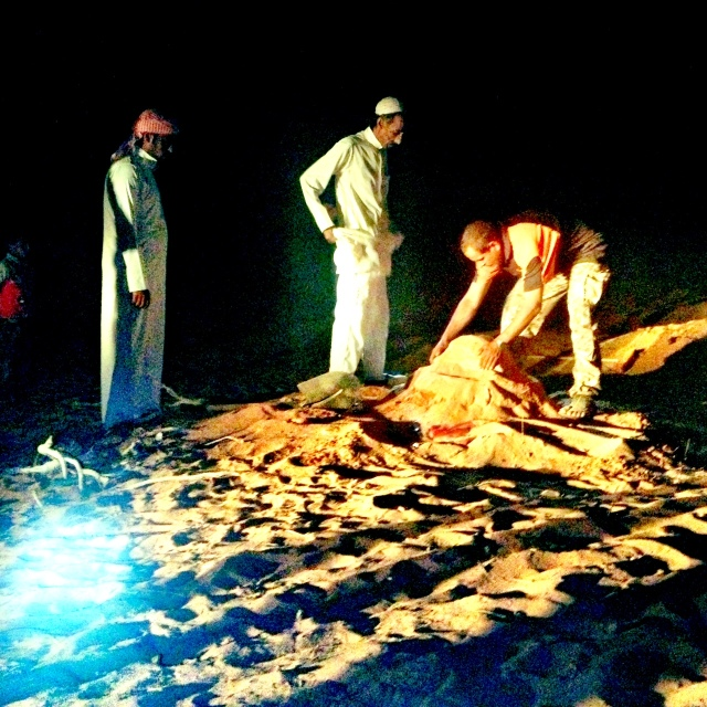 bedouins unearthing the zarb in wadi rum.
