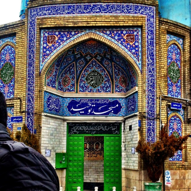 a mosque close to the grand bazaar of tehran which is decorated with beautiful blue mosaics